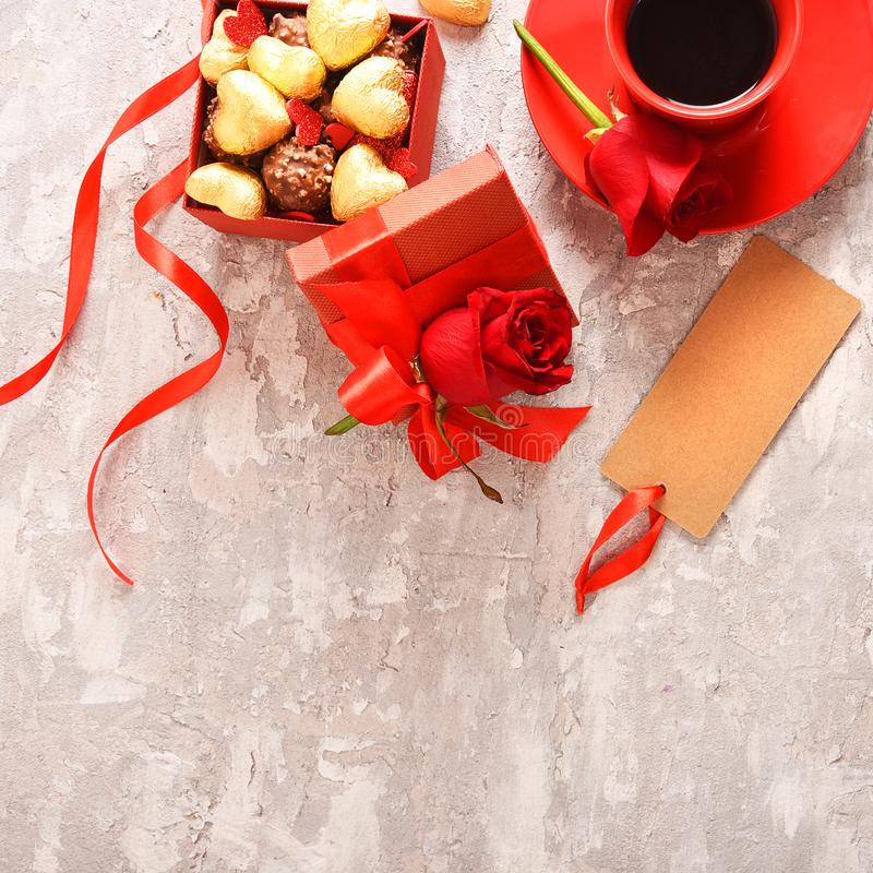 Composition for Valentine`s Day. Roses, gift, glasses and wine, red hearts. Top view. stock photography
