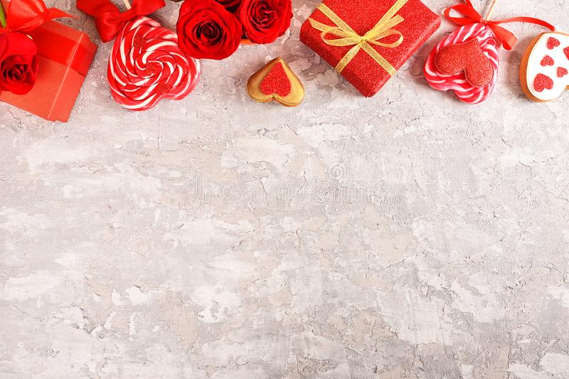 Composition for Valentine`s Day. Roses, gift, glasses and wine, red hearts. Top view. royalty free stock image