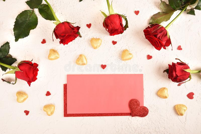 Composition for Valentine`s Day. Roses, gift, glasses and wine, red hearts. Top view. stock photo