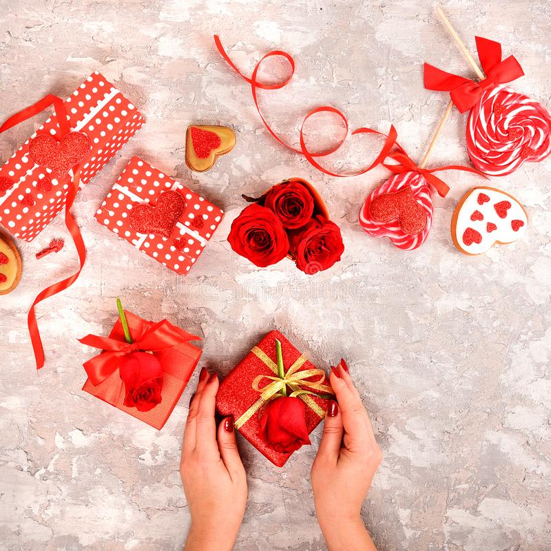 Composition for Valentine`s Day. Roses, gift, glasses and wine, red hearts. Top view. royalty free stock photos