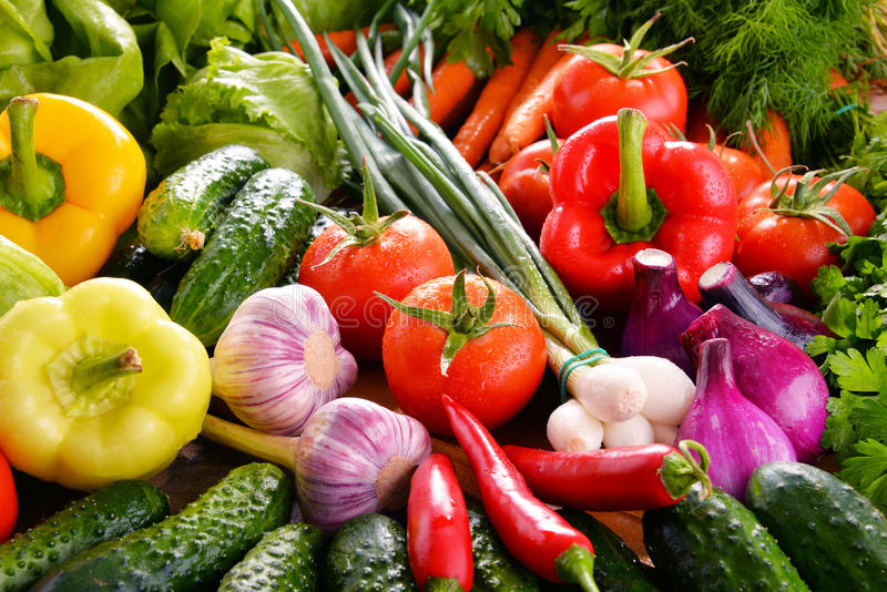 Composition with variety of fresh organic vegetables and fruits.  royalty free stock images