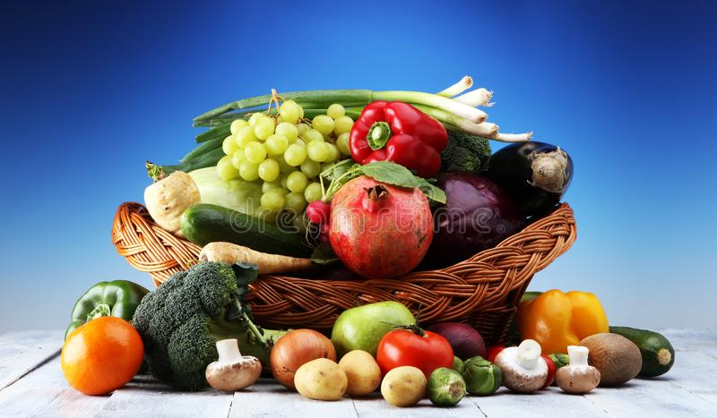 Composition with variety of raw organic vegetables and fruits. Balanced diet. stock photo