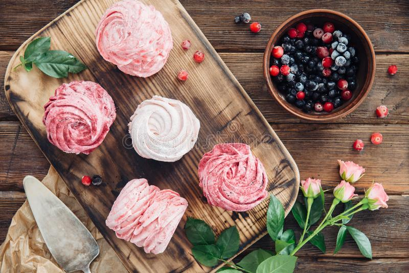 Composition of various blueberry, cherries meringues and flowers stock photos
