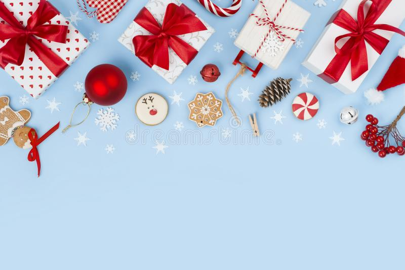 Composition of various Christmas decoration objects on blue frosty background.  royalty free stock image