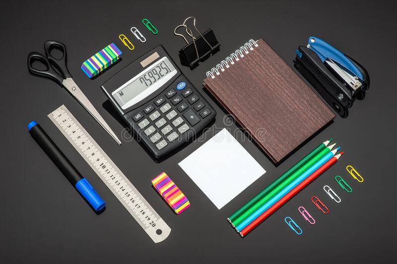 Composition with various school stationery and calculator on glass background stock photos