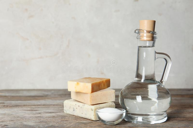 Composition with vinegar, baking soda and soap bars for cleaning on table. royalty free stock photography