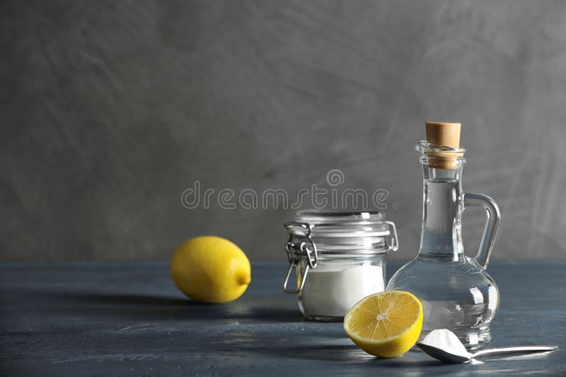 Composition with vinegar, lemon and baking soda on table. Space for text royalty free stock images