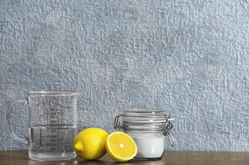 Composition with vinegar, lemons and baking soda on table. stock image