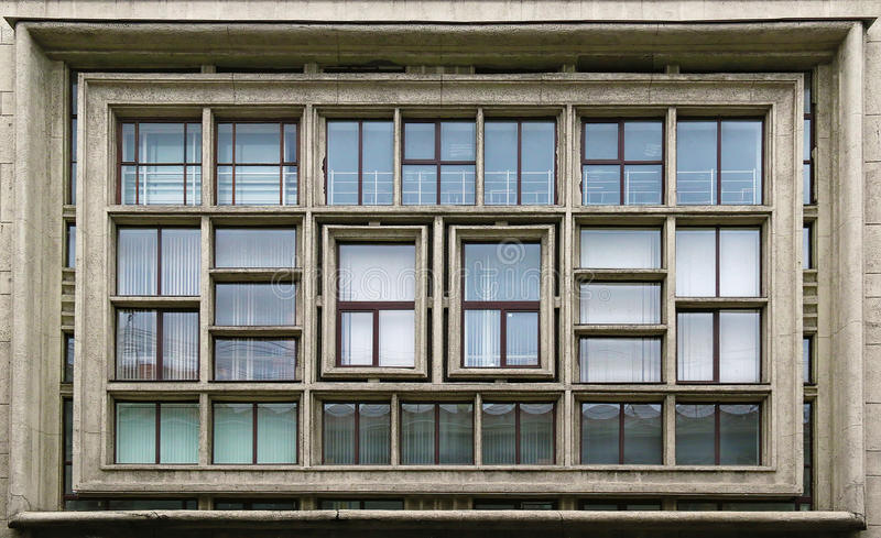 Composition of windows on facade. The symmetrical composition of multiple windows on the facade of non-residential building, St. Petersburg, Russia stock image