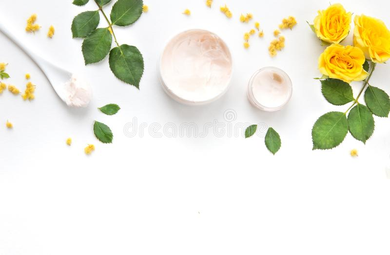 Composition with yellow roses and hand cream. morning face and body care. spa and massage stock photos