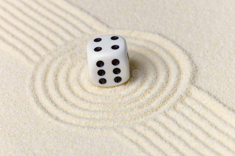 Composition on Zen garden - sand, and dice stock image
