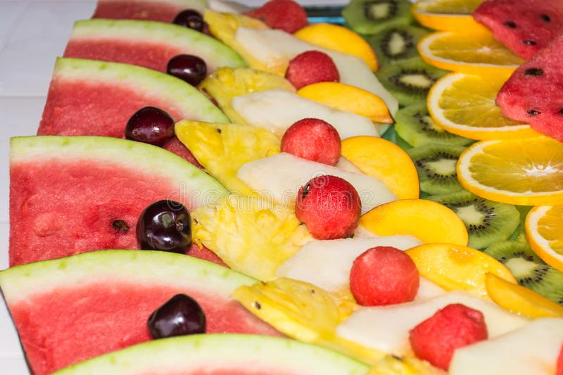 Compositions or architecture of fresh fruit cut for buffets. Typical summer fruits of Sicily, refreshing and healthy royalty free stock photography