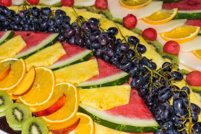 Compositions or architecture of fresh fruit cut for buffets. Typical summer fruits of Sicily, refreshing and healthy stock images