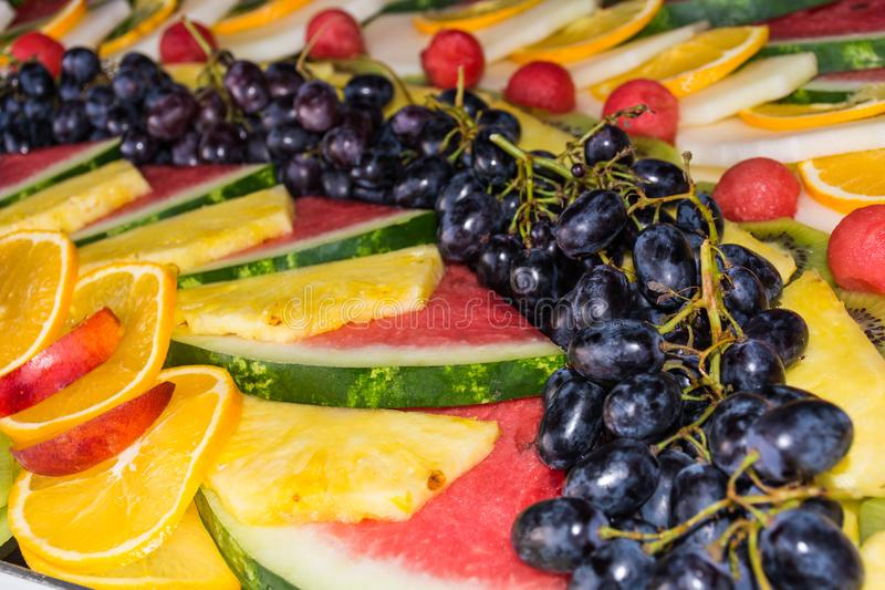 Compositions or architecture of fresh fruit cut for buffets. Typical summer fruits of Sicily, refreshing and healthy royalty free stock photos