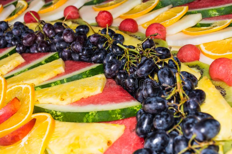 Compositions or architecture of fresh fruit cut for buffets. Typical summer fruits of Sicily, refreshing and healthy stock photography