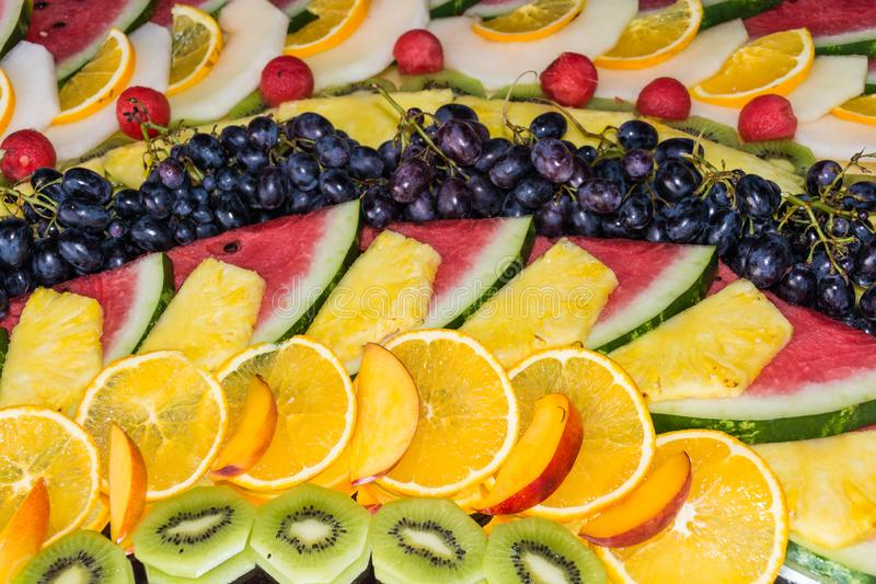 Compositions or architecture of fresh fruit cut for buffets. Typical summer fruits of Sicily, refreshing and healthy stock photo