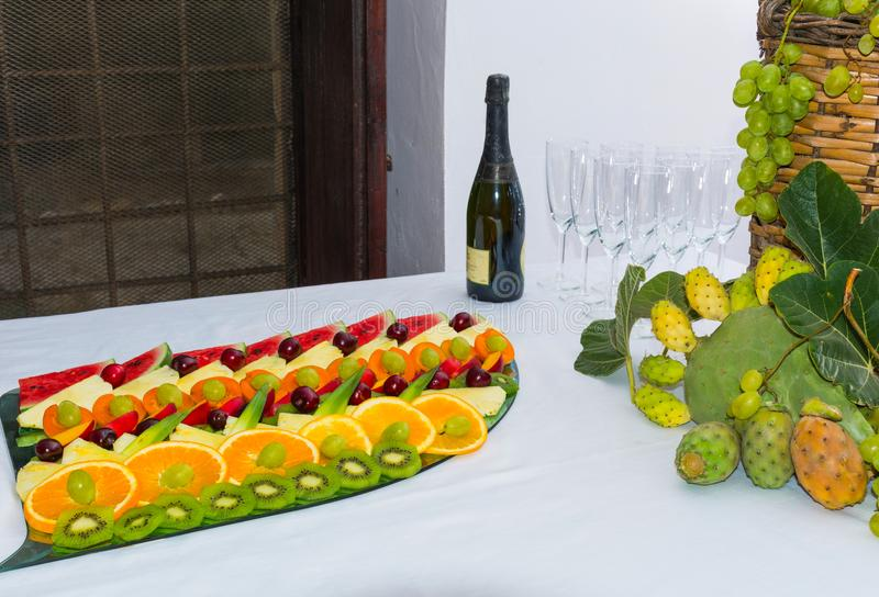 Compositions of fresh fruit cut for buffets. Typical summer fruits of Sicily, refreshing and healthy stock photography
