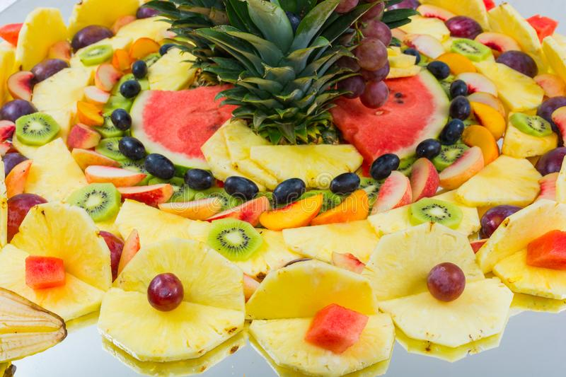 Compositions of fresh fruit cut for buffets. Typical summer fruits of Sicily, refreshing and healthy royalty free stock photos