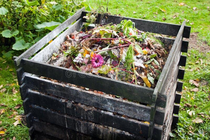 Compost bin. In the garden stock photos
