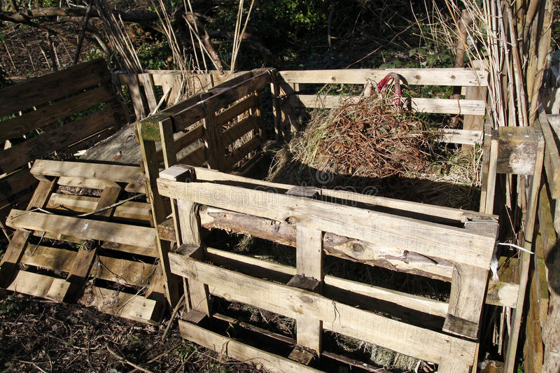Compost bins made from old pallets. In an allotment stock images