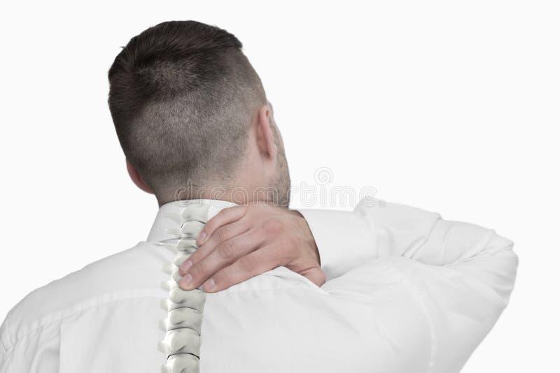Composto di Digital della spina dorsale Highlighted dell'uomo con dolore alla schiena immagini stock libere da diritti