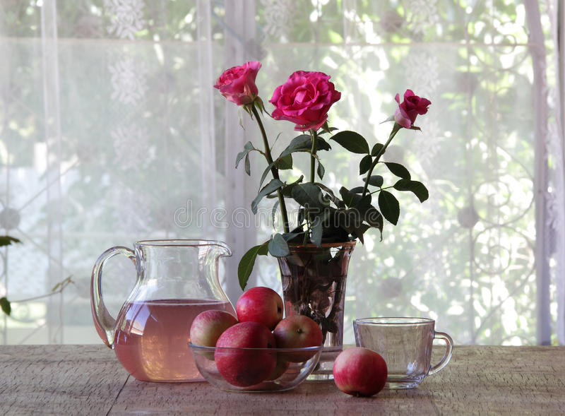 Compote from apples in a transparent jug royalty free stock images