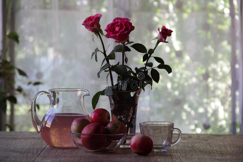 Compote from apples in a transparent jug stock images