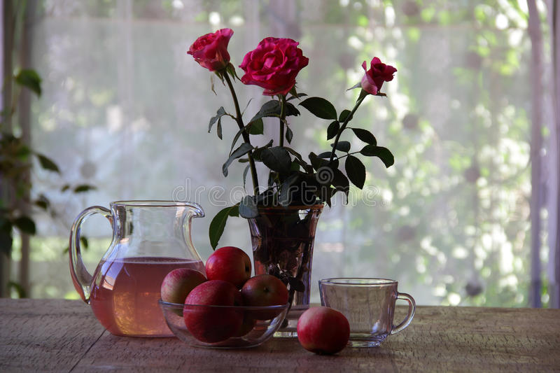 Compote from apples in a transparent jug royalty free stock photos