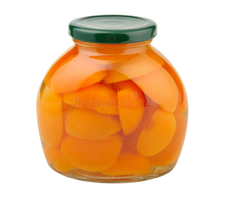 Compote of apricots. In a glass jar on white royalty free stock image