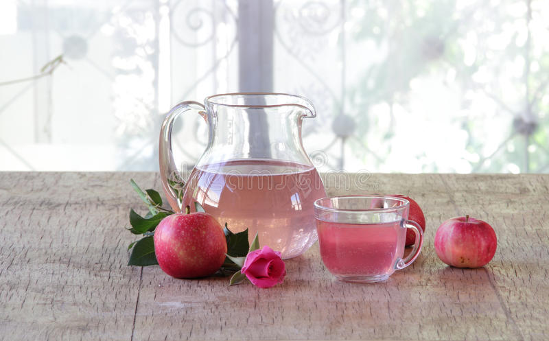 Compote from fresh apples in a jug stock images
