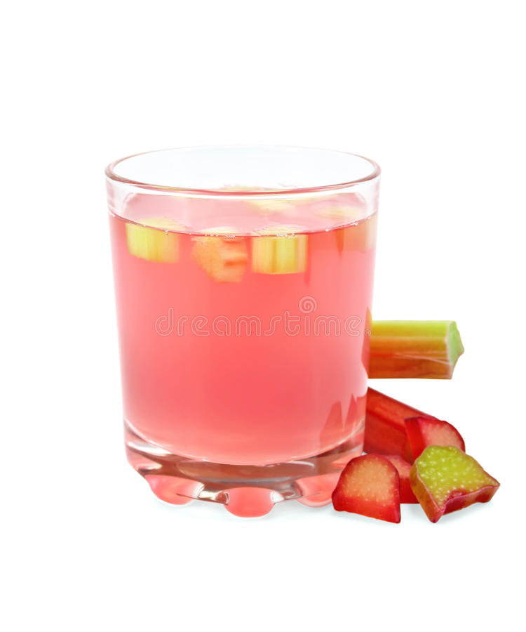 Compote from rhubarb in glassful with petioles royalty free stock photo