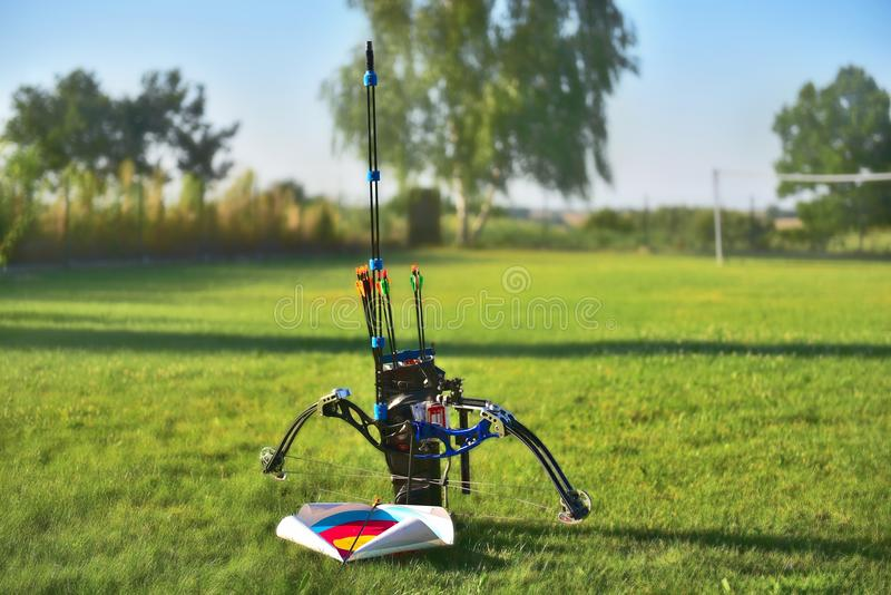 Compound bow. With all the instrumentation on a blurry background of natural greenery stock photo
