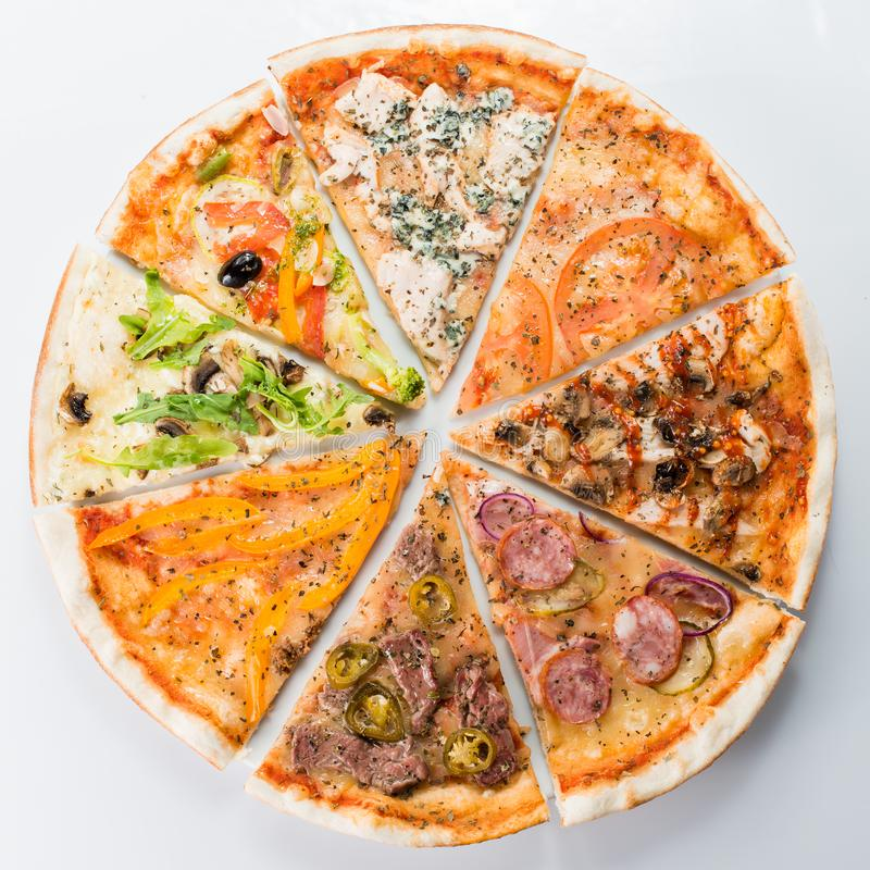 Compound pizza from slices of different italian pizzas stock images