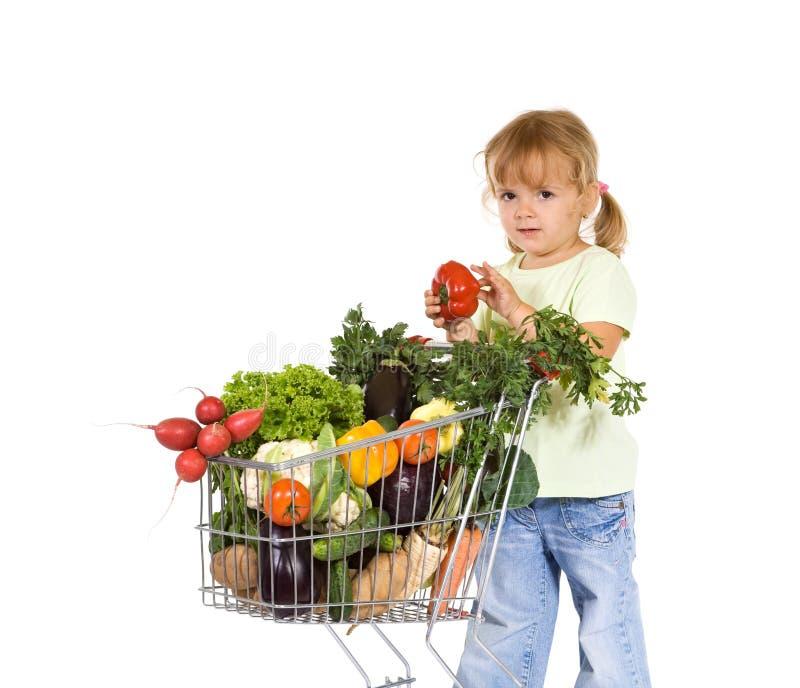Compra da menina para o alimento saudável fotos de stock