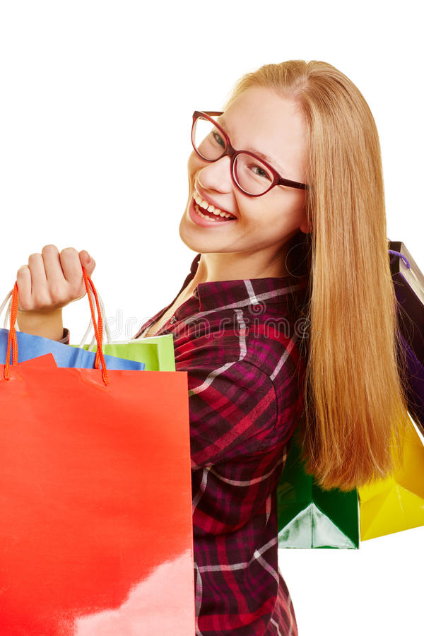 Compra de sorriso da mulher imagem de stock