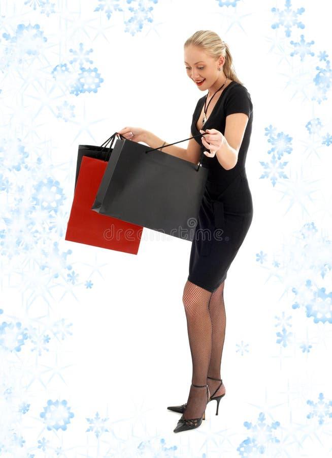 Compra eufórico loura com flocos de neve imagem de stock royalty free