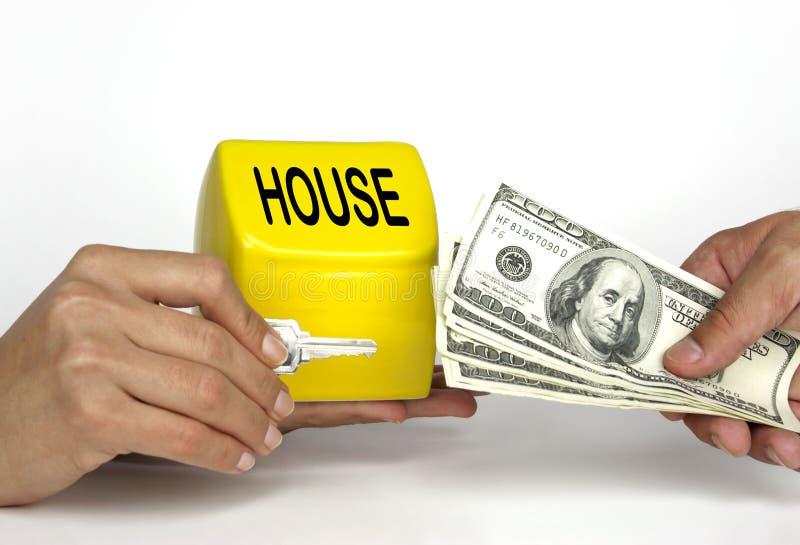 Comprando e vendendo uma casa ou uma HOME fotos de stock