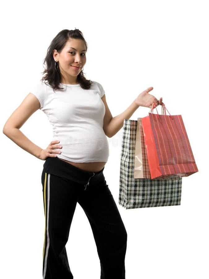 Compras de la mujer embarazada imagen de archivo