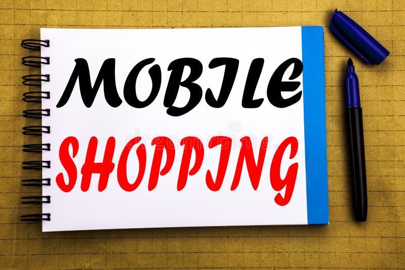 Compras móviles Concepto del negocio para la orden en línea del teléfono móvil escrita en fondo del papel de nota de la libreta c foto de archivo libre de regalías