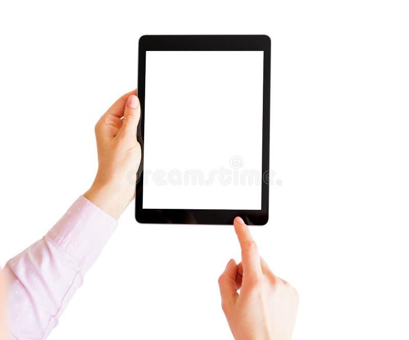 Compressa della tenuta della donna e schermo commovente con il dito fotografie stock