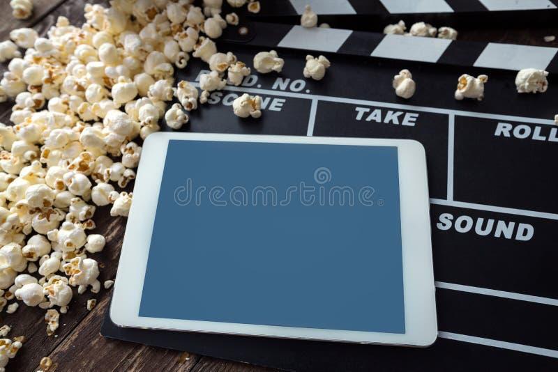 Compressa di Digital con popcorn immagine stock libera da diritti