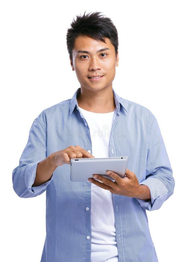 Compressa digitale di uso asiatico dell'uomo immagine stock