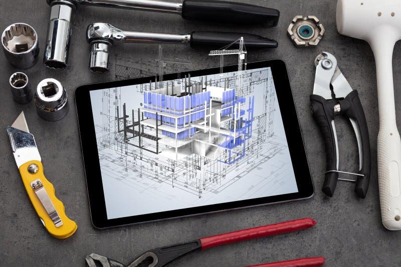 Compressa e strumenti con il concetto della pianta della casa 3d fotografia stock