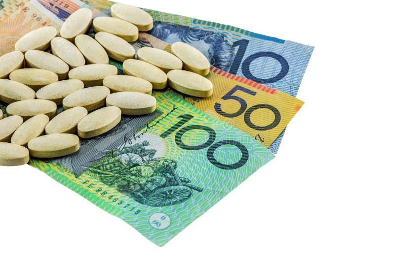 Compresse della medicina sulle banconote dell'Australia fotografia stock