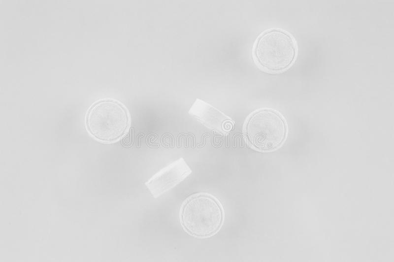 Compressed, dry, biodegradable coin tissues on a white background. Tablet tissues in practical and compact pill form. royalty free stock image