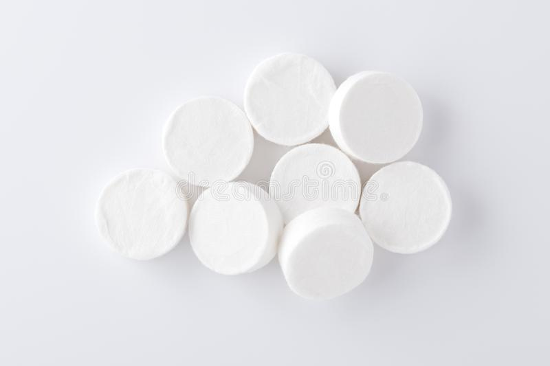 Compressed facial mask sheets on white background royalty free stock image
