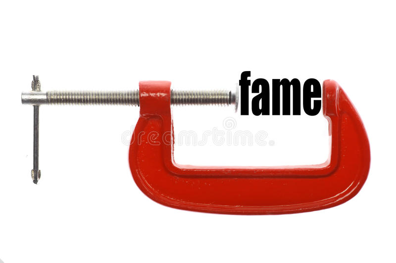 Compressed fame concept. The word fame is compressed with a vice royalty free stock photo