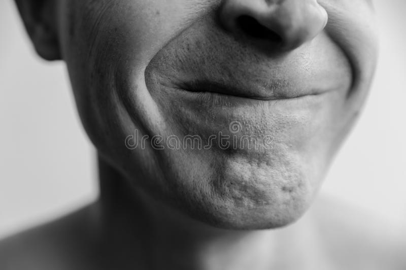 Compressed lips closeup. The lower part of the face of a man. Black and white images royalty free stock photo