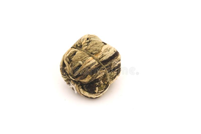 Compressed traditional chinese tea on a white background, closeup shot. Aroma, aromatic, asian, china, circle, drink, dry, exotic, green, leaf, pu-erh, puer stock photography