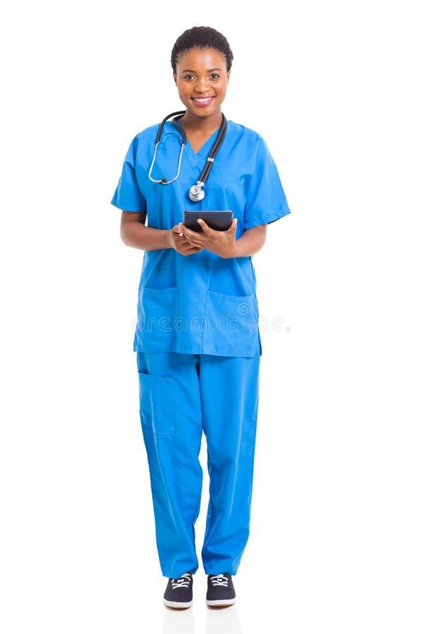 Comprimé africain d'infirmière photographie stock